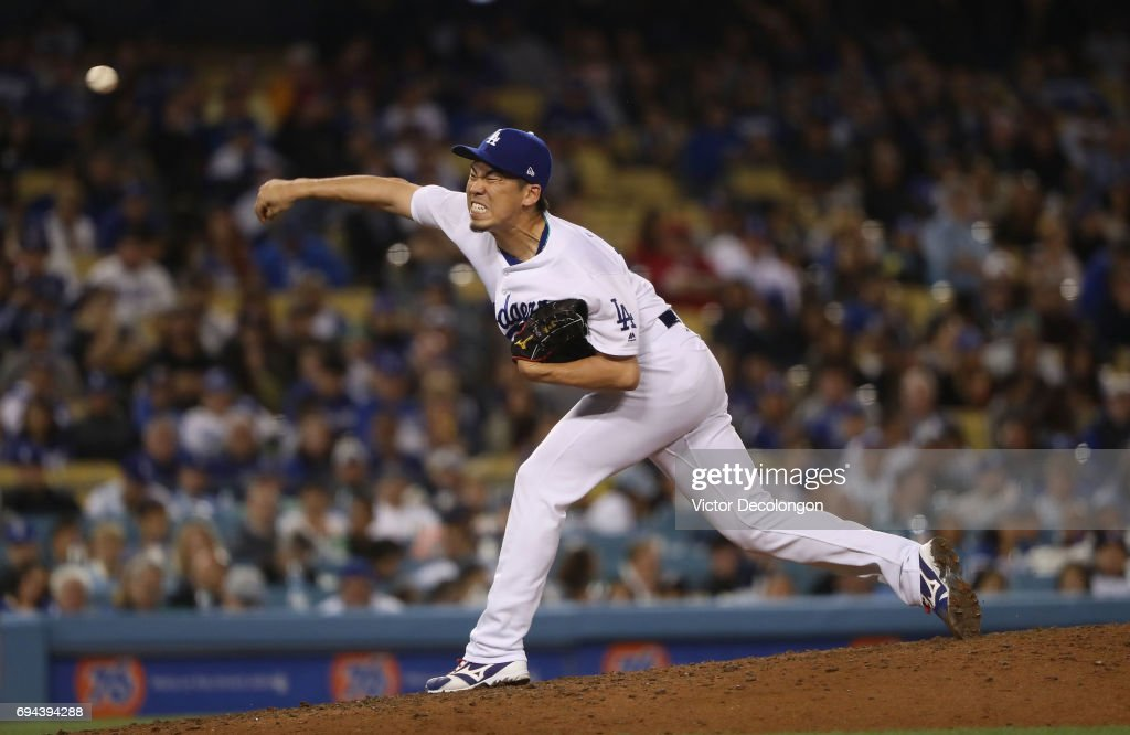 Pitcher Kenta Maeda #18 of the Los Angeles Dodgers pitches in relief in the eighth inning during the MLB game against the Cincinnati Reds at Dodger Stadium on June 9, 2017 in Los Angeles, California.