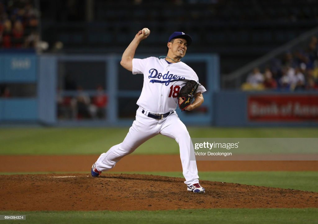 Pitcher Kenta Maeda #18 of the Los Angeles Dodgers pitches in relief in the seventh inning during the MLB game against the Cincinnati Reds at Dodger Stadium on June 9, 2017 in Los Angeles, California.
