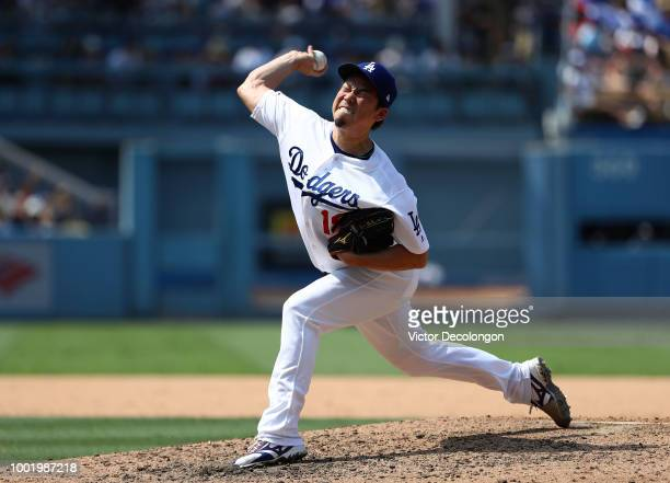 Pitcher Kenta Maeda of the Los Angeles Dodgers pitches in relief during the seventh inning of the MLB game against the Los Angeles Angels of Anaheim...