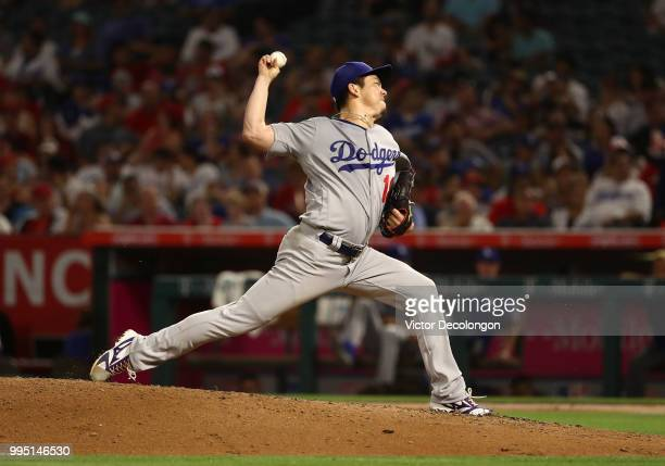 Pitcher Kenta Maeda of the Los Angeles Dodgers pitches in the fifth inning during the MLB game against the Los Angeles Angels of Anaheim at Angel...