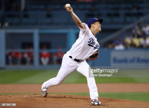 Pitcher Kenta Maeda of the Los Angeles Dodgers pitches in the first inning during the MLB game against the Cincinnati Reds at Dodger Stadium on May...