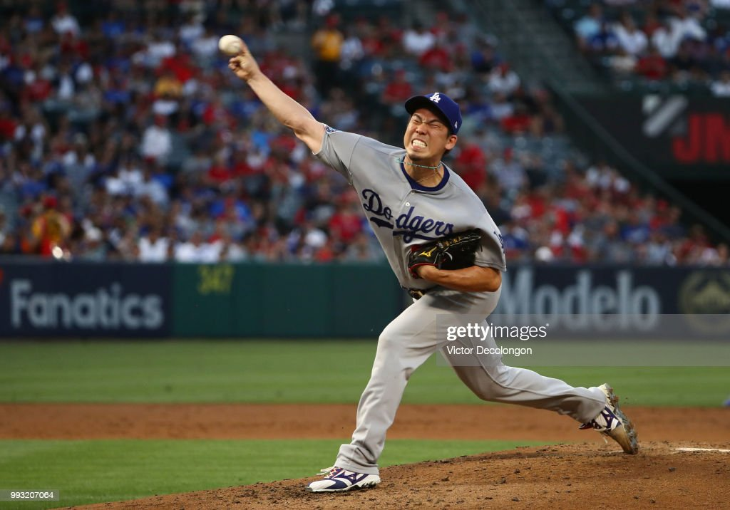 Pitcher Kenta Maeda #18 of the Los Angeles Dodgers pitches in the second inning during the MLB game against the Los Angeles Angels of Anaheim at Angel Stadium on July 6, 2018 in Anaheim, California. The Angels defeated the Dodgers 3-2.
