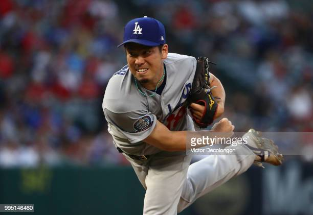 Pitcher Kenta Maeda of the Los Angeles Dodgers pitches in the second inning during the MLB game against the Los Angeles Angels of Anaheim at Angel...
