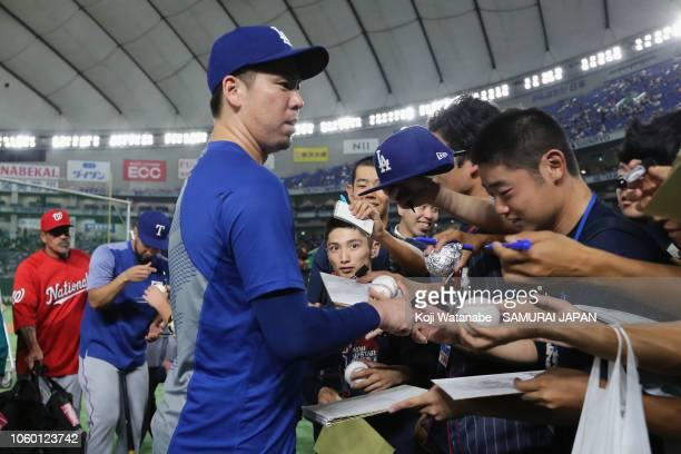 Pitcher Kenta Maeda of the Los Angeles Dodgers signs autographs for fans prior to the game three of Japan and MLB All Stars at Tokyo Dome on November...
