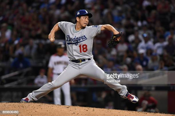 Pitcher Kenta Maeda of the Los Angeles Dodgers throws during the eighth inning of the National League Divisional Series game three against the...