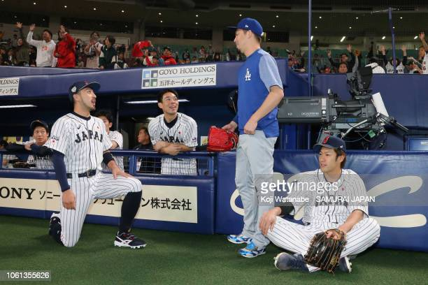 Pitcher Kenta Maeda of the Los Angeles Dodgers visits the Japanese dugout prior to the game five between Japan and MLB All Stars at Nagoya Dome on...