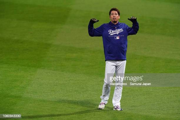 Pitcher Kenta Maeda of the Los Angeles Dodgers warms up prior to the game four between Japan and MLB All Stars at Mazda Zoom Zoom Stadium Hiroshima...