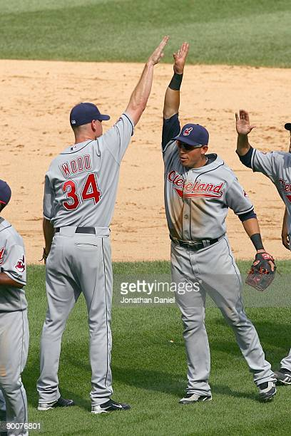 Pitcher Kerry Woods of the Cleveland Indians celebrates with Asdrubal Cabrera after winning the game against the Chicago White Sox on August 9, 2009...