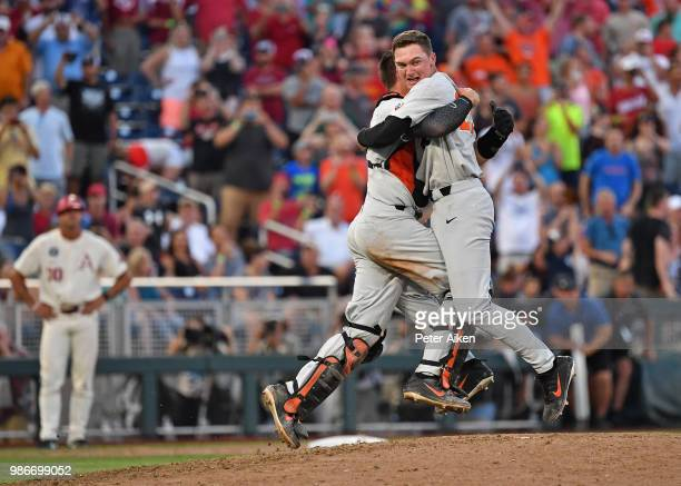 Pitcher Kevin Abel of the Oregon State Beavers and Catcher Adley Rutschman embrace to celebrate after defeating the Arkansas Razorbacks for the...