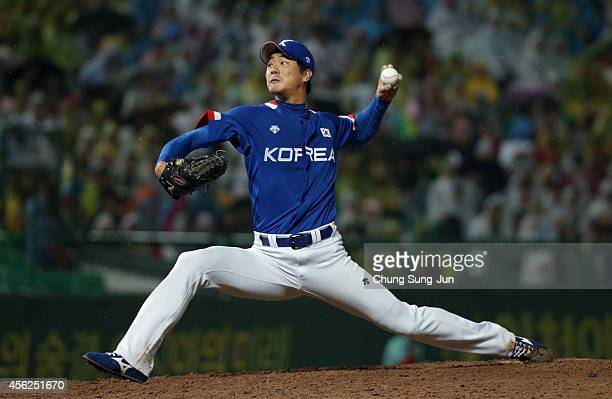 Pitcher Kim KwangHyun of South Korea pitches in the sixth inning during the Baseball Final between South Korea and Chinese Taipei during the day nine...