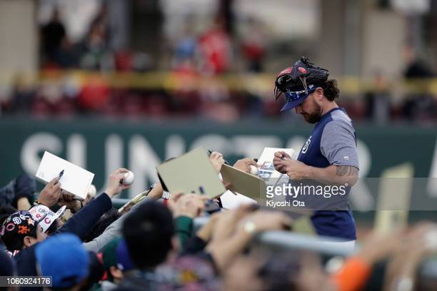 Pitcher Kirby Yates of the San Diego Padres signs autographs for fans prior to the game four between Japan and MLB All Stars at Mazda Zoom Zoom...