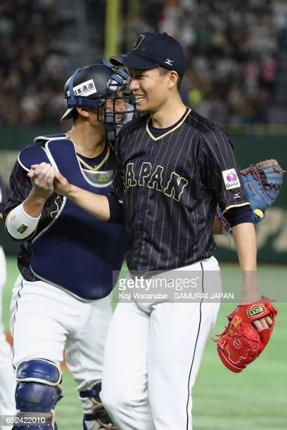 Pitcher Kohdai Senga of Japan is congratulated by Catcher Seiji Kobayashi after the bottom of the fifth inning during the World Baseball Classic Pool...