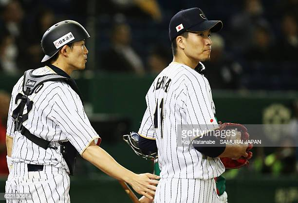 Pitcher Kohdai Senga of Japan is consoled by Catcher Shota Ohno in the sixth inning during the international friendly match between Japan and Mexico...