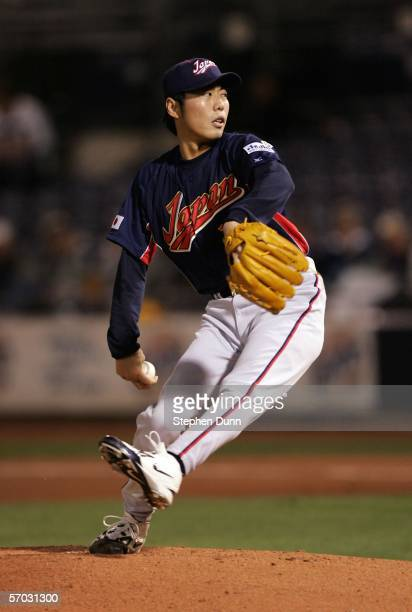 Pitcher Koji Uehara of Team Japan throws a pitch against the Seattle Mariners on March 8 2006 at Peoria Sports Complex in Peoria Arizona Team Japan...