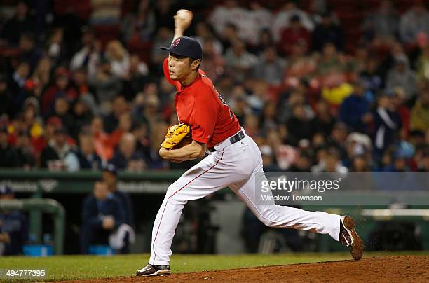 Pitcher Koji Uehara of the Boston Red Sox pitches during the ninth inning of the game against the Tampa Bay Rays at Fenway Park on May 30 2014 in...