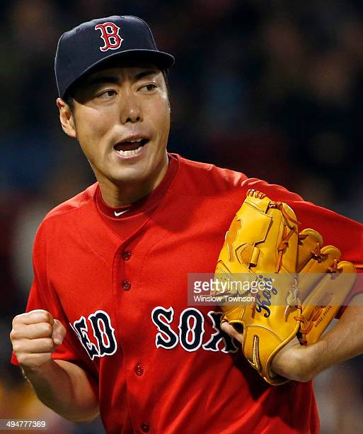 Pitcher Koji Uehara of the Boston Red Sox pumps his fist during the ninth inning of the game against the Tampa Bay Rays at Fenway Park on May 30 2014...