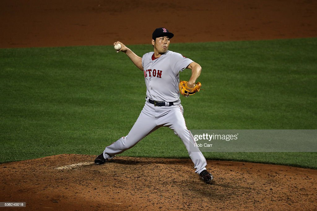 Pitcher Koji Uehara #19 of the Boston Red Sox throws to a Baltimore Orioles batter in the eighth inning at Oriole Park at Camden Yards on May 31, 2016 in Baltimore, Maryland.