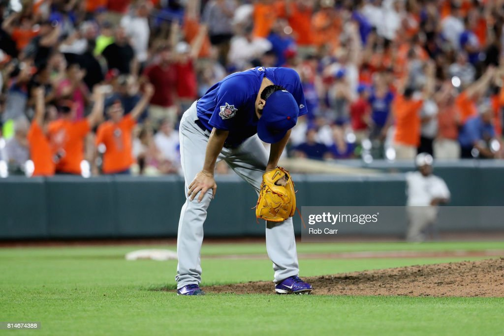 Pitcher Koji Uehara #19 of the Chicago Cubs reacts after giving up a two run homer against the Baltimore Orioles in the eighth inning at Oriole Park at Camden Yards on July 14, 2017 in Baltimore, Maryland.