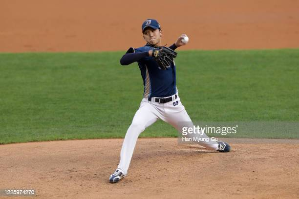 Pitcher Koo Chang-Mo of NC Dinos throws in the bottom of the first inning during the KBO League game between NC Dinos and Doosan Bears at the Jamsil...