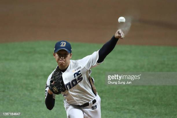Pitcher Koo Chang-Mo of NC Dinos throws in the top of first inning during the Korean Series Game Five between Doosan Bears and NC Dinos at the...