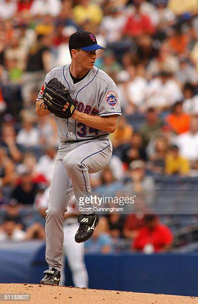 Pitcher Kris Benson of the New York Mets works against the Atlanta Braves in a game on July 31 2004 at Turner Field in Atlanta Georgia