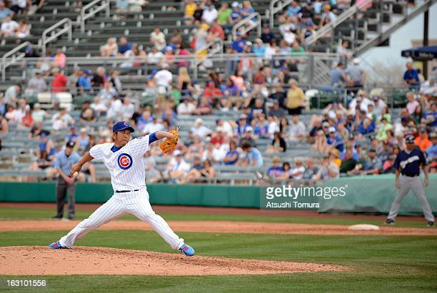 Pitcher Kyuji Fujikawa of Chicago Cubs throws during the spring training match against Milwaukee Brewers on March 3 2013 in Mesa Arizona
