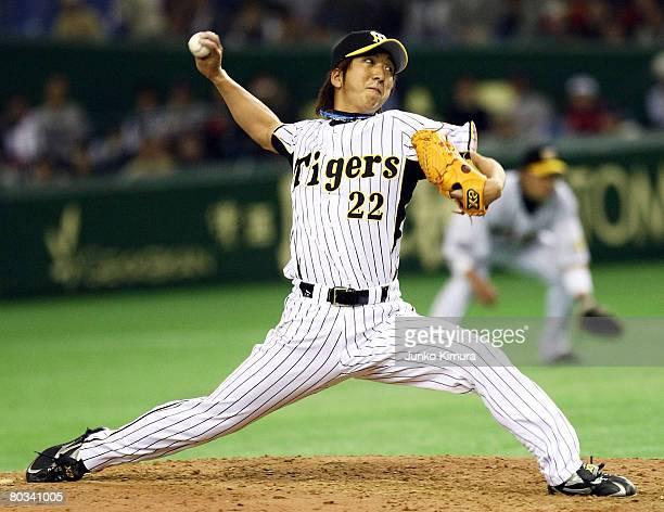Pitcher Kyuji Fujikawa of Hanshin Tigers pitches during preseason friendly between Boston Red Sox and Hanshin Tigers at Tokyo Dome on March 22 2008...