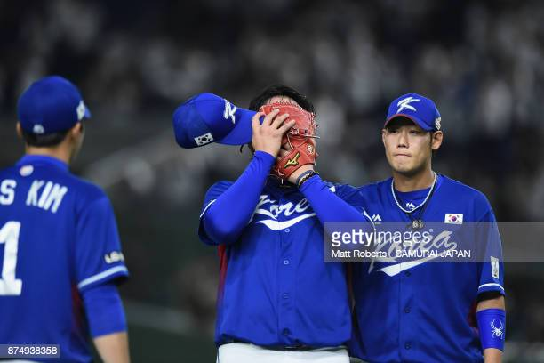 Pitcher Lee Minho of South Korea shows dejection after allowing a gamewinning double to Catcher Tatsuhiro Tamura of Japan in the bottom of tenth...