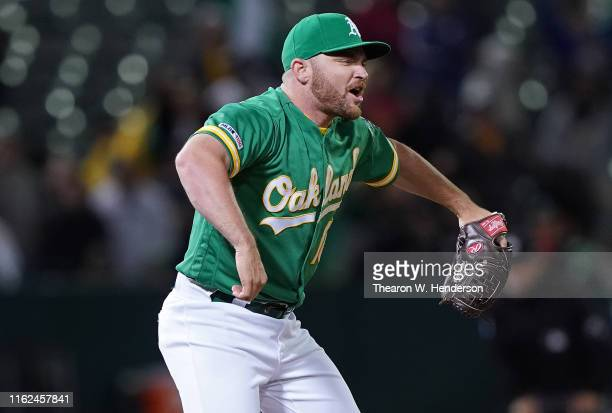 Pitcher Liam Hendriks of the Oakland Athletics reacts after striking out Yoan Moncada of the Chicago White Sox for the final out of the game at Ring...