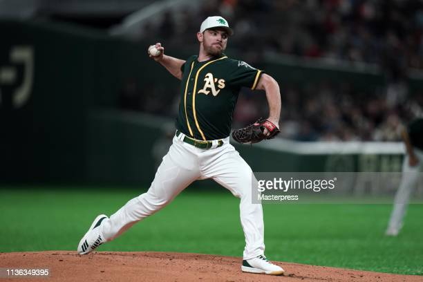 Pitcher Liam Hendriks of the Oakland Athletics throws in the bottom of 1st inning during the game between Hokkaido NipponHam Fighters and Oakland...