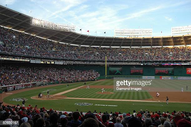 Pitcher Livan Hernandez of the Washington Nationals delivers the first pitch at home for the new Washington Nationals as they open their home season...