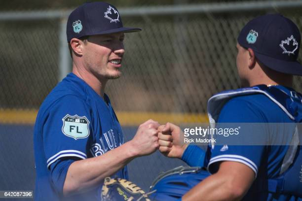 Pitcher Lucas Harrell and catcher Reese McGuire fist pump after Harrell's time on he mound Toronto Blue Jays continue the preparations for the...
