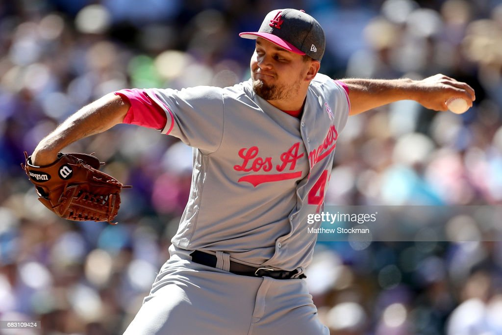 Pitcher Luis Avilan #43 of the Los Angeles Dodgers throws in the sixth inning against the Colorado Rockies at Coors Field on May 14, 2017 in Denver, Colorado. Members of both teams were wearing pink in commemoration of Mother's Day weekend.