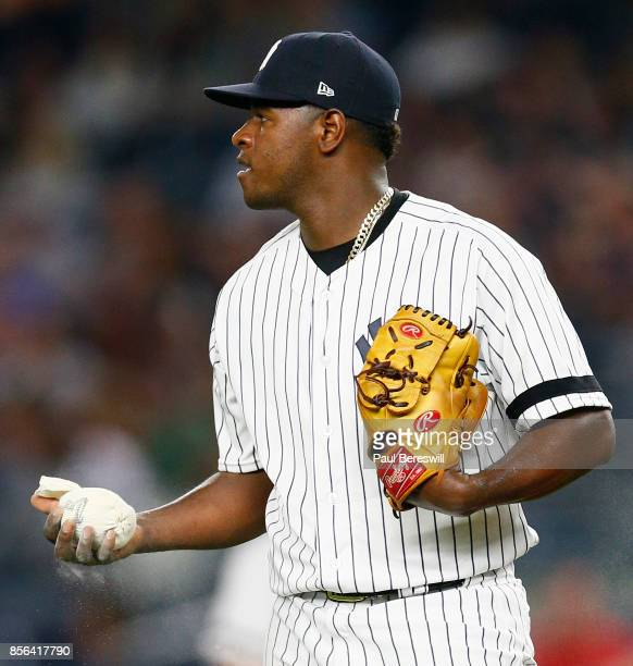 Pitcher Luis Severino of the New York Yankees squeezes the rosin bag as he reacts in an MLB baseball game against the Baltimore Orioles on September...