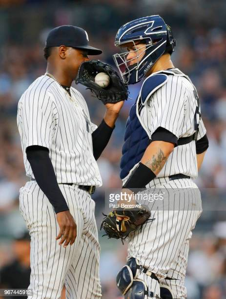 Pitcher Luis Severino talks with catcher Gary Sanchez of the New York Yankees pitches in an MLB baseball game against the Los Angeles Angels on May...