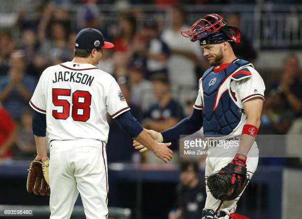 Pitcher Luke Jackson of the Atlanta Braves shakes hands with catcher Tyler Flowers after the game Philadelphia Phillies at SunTrust Park on June 7...