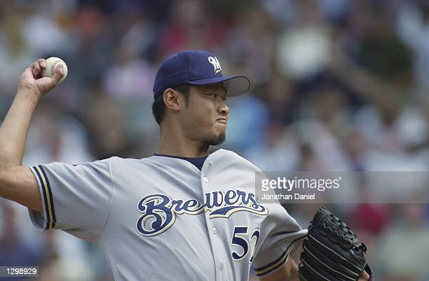 Pitcher Mac Suzuki of the Milwaukee Brewers throws against the Chicago Cubs in the second inning of the game on August 28 2001 at Wrigley Field in...