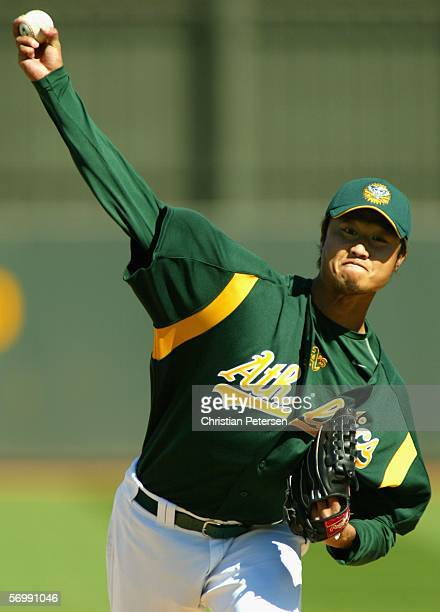 Pitcher Mac Suzuki of the Oakland Athletics pitches against the Milwaukee Brewers during the MLB Spring Training game at Phoenix Municipal Stadium on...