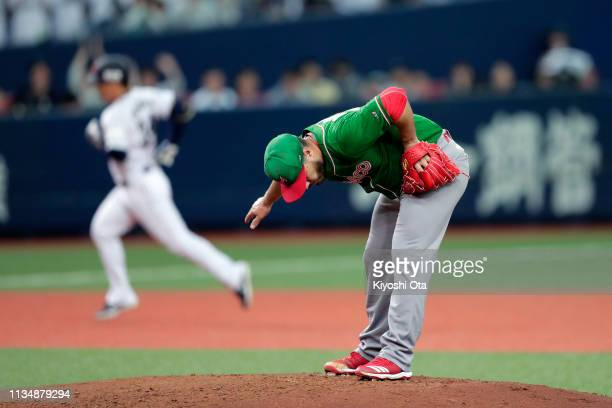 Pitcher Manny Barreda of Mexico shows dejection after allowing a grand slam to Outfielder Masataka Yoshida of Japan in the bottom of 1st inning...