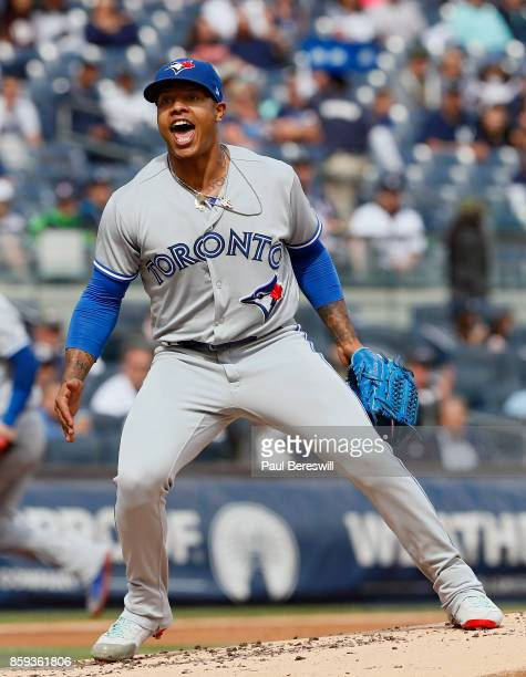Pitcher Marcus Stroman of the Toronto Blue Jays reacts to getting a double play to end the first inning with two men on base in an MLB baseball game...