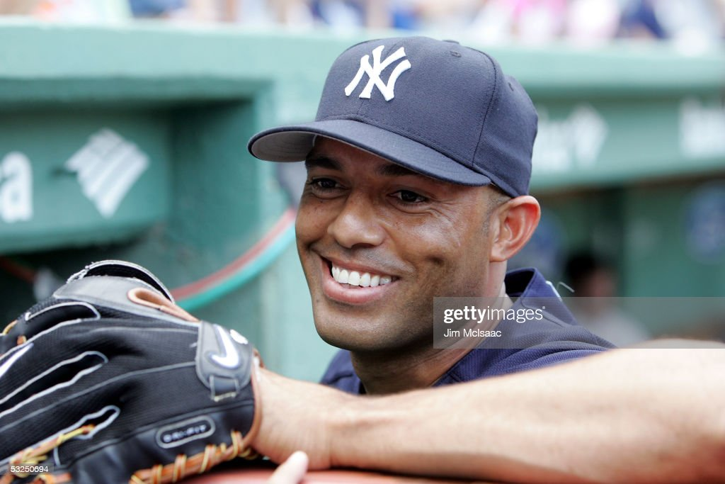 Pitcher Mariano Rivera #42 of the New York Yankees talks to friends before the start of their game against the Boston Red Sox at Fenway Park on July 17, 2005 in Boston, Massachusetts. The Yankees defeated the Red Sox 5-3.