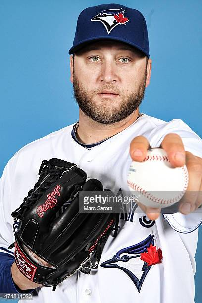 Pitcher Mark Buehrle of the Toronto Blue Jays poses for photos on media day on February 25 2014 in Dunedin Florida