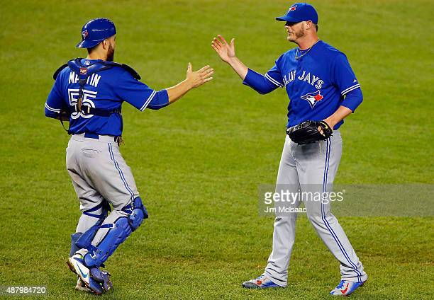 Pitcher Mark Lowe and catcher Russell Martin of the Toronto Blue Jays celebrate after defeating the New York Yankees at Yankee Stadium on September...