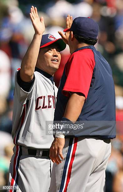 Pitcher Masahide Kobayashi of the Cleveland Indians celebrates with Asdrubal Cabrera after defeating the Seattle Mariners 96 on July 19 2008 at...