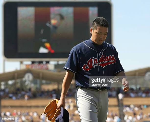 Pitcher Masahide Kobayashi of the Cleveland Indians walks off the field after pitching a scoreless 10th inning against the Los Angeles Dodgers at...