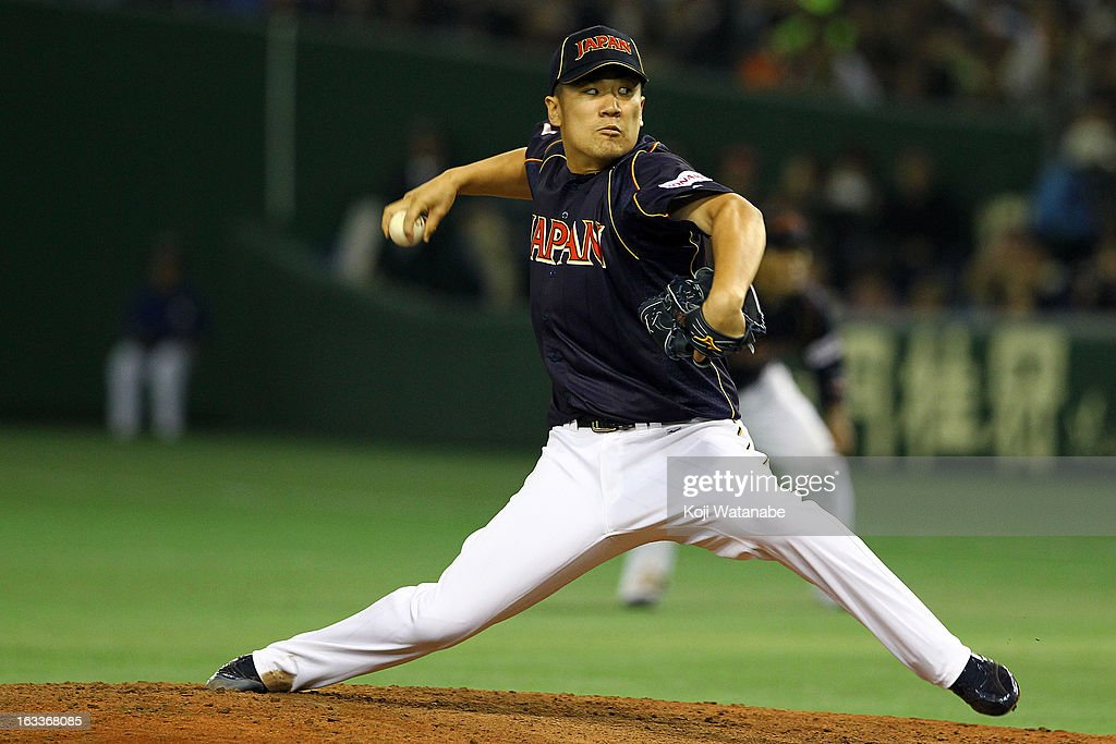 Pitcher Masahiro Tanaka #17 of Japan pitches during the World Baseball Classic Second Round Pool 1 game between Japan and Chinese Taipei at Tokyo Dome on March 8, 2013 in Tokyo, Japan.
