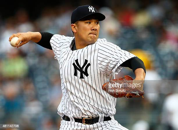 Pitcher Masahiro Tanaka of the New York Yankees delivers a pitch against the Seattle Mariners during the first inning of a MLB baseball game at...