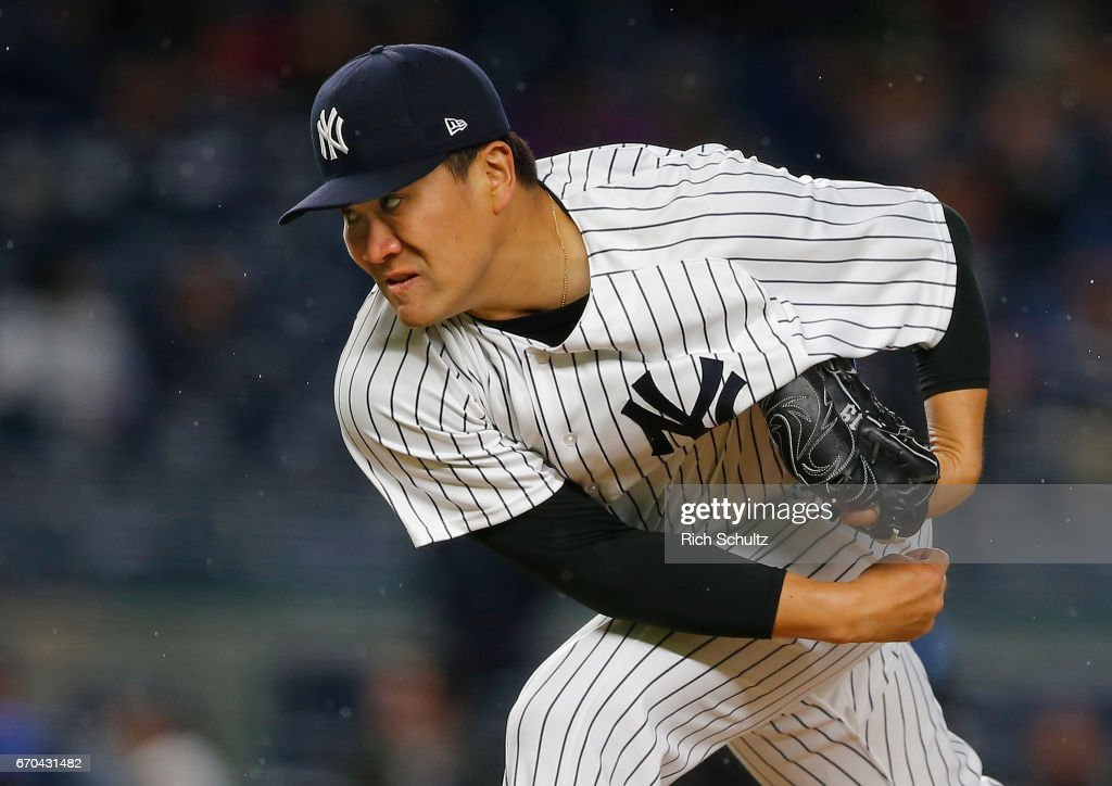 Pitcher Masahiro Tanaka #19 of the New York Yankees delivers a pitch against the Chicago White Sox during the second inning of a game at Yankee Stadium on April 19, 2017 in New York City. The Yankees defeated the White Sox 9-1.