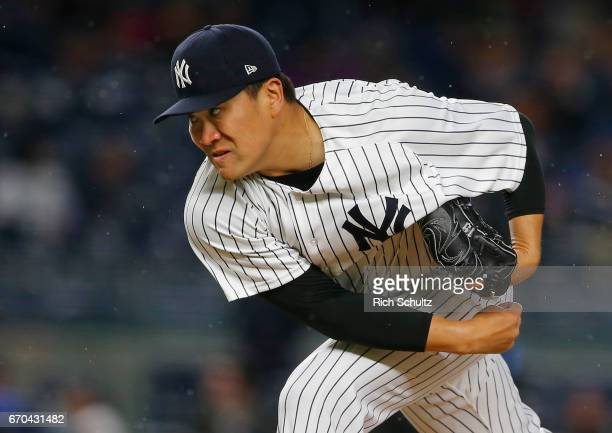 Pitcher Masahiro Tanaka of the New York Yankees delivers a pitch against the Chicago White Sox during the second inning of a game at Yankee Stadium...