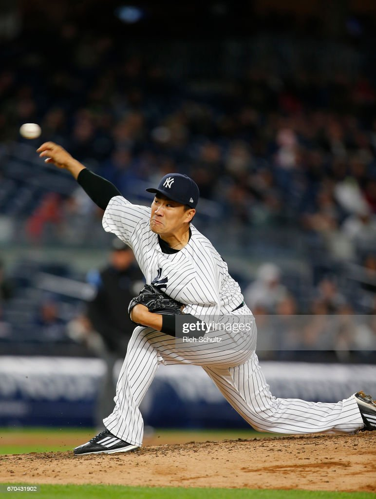 Pitcher Masahiro Tanaka #19 of the New York Yankees delivers a pitch against the Chicago White Sox during the seventh inning of a game at Yankee Stadium on April 19, 2017 in New York City. The Yankees defeated the White Sox 9-1.